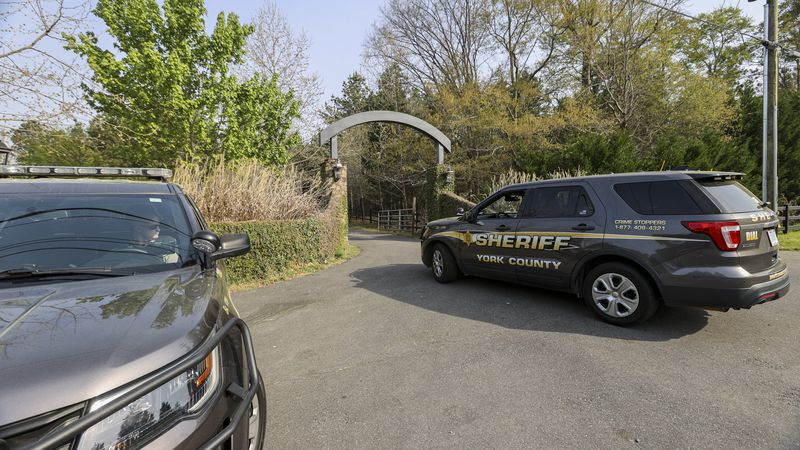 A York County sheriff vehicle drives onto the property where multiple people, including a...
