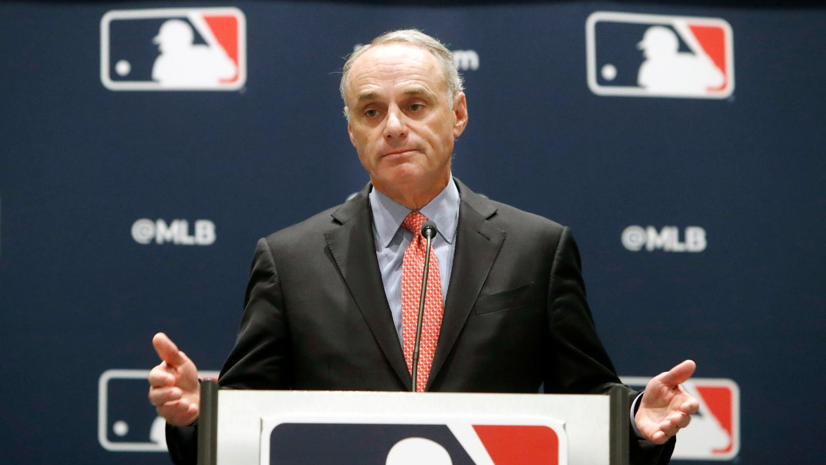 In this Nov. 21, 2019, file photo, baseball commissioner Rob Manfred speaks to the media at the...