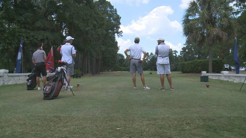 Players wait to tee off on the 16th hole at Palmetto Golf Club.