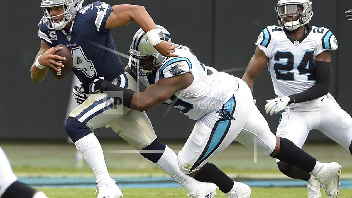 Dallas Cowboys' Dak Prescott (4) is sacked by Carolina Panthers' Kawann Short (99) during the...