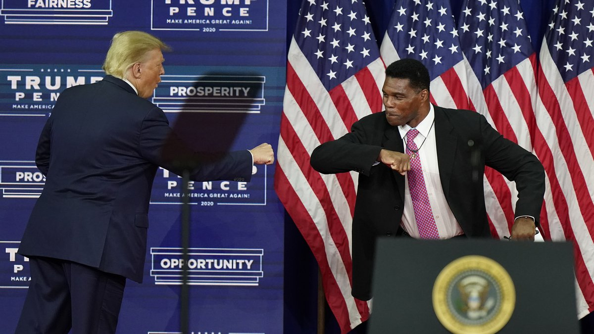 FILE - In this Sept. 25, 2020, file photo, President Donald Trump elbow bumps with Herschel...