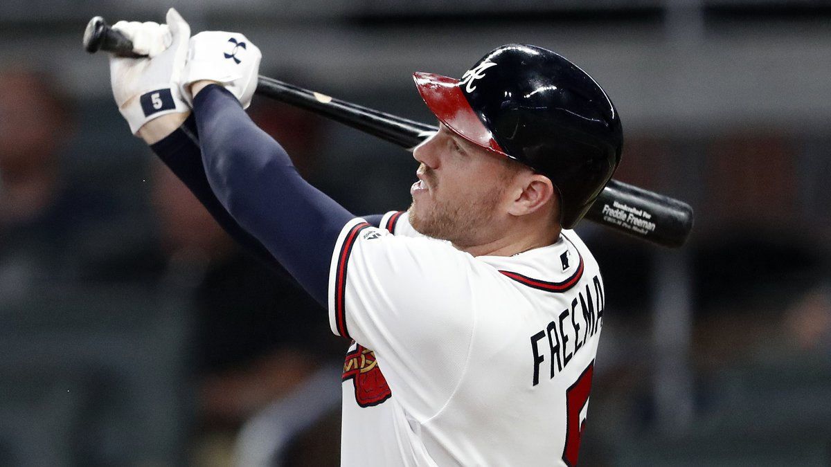 Atlanta Braves' Freddie Freeman (5) connects on a solo-home run in the sixth inning of a...
