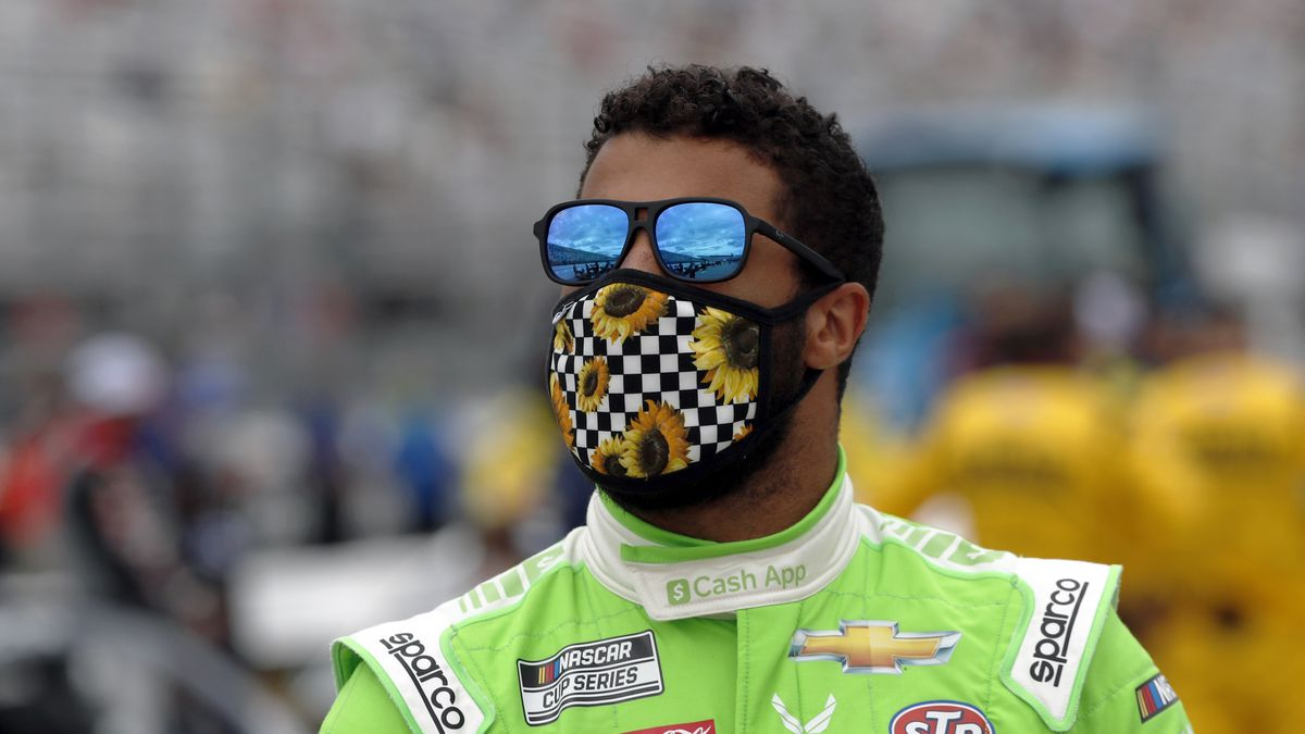Driver Bubba Wallace waits for the start of a NASCAR Cup Series auto race, Sunday, Aug. 2,...