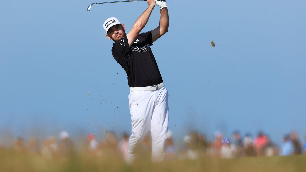 SANDWICH, ENGLAND - JULY 16: Louis Oosthuizen of South Africa plays his second shot on the 8th...