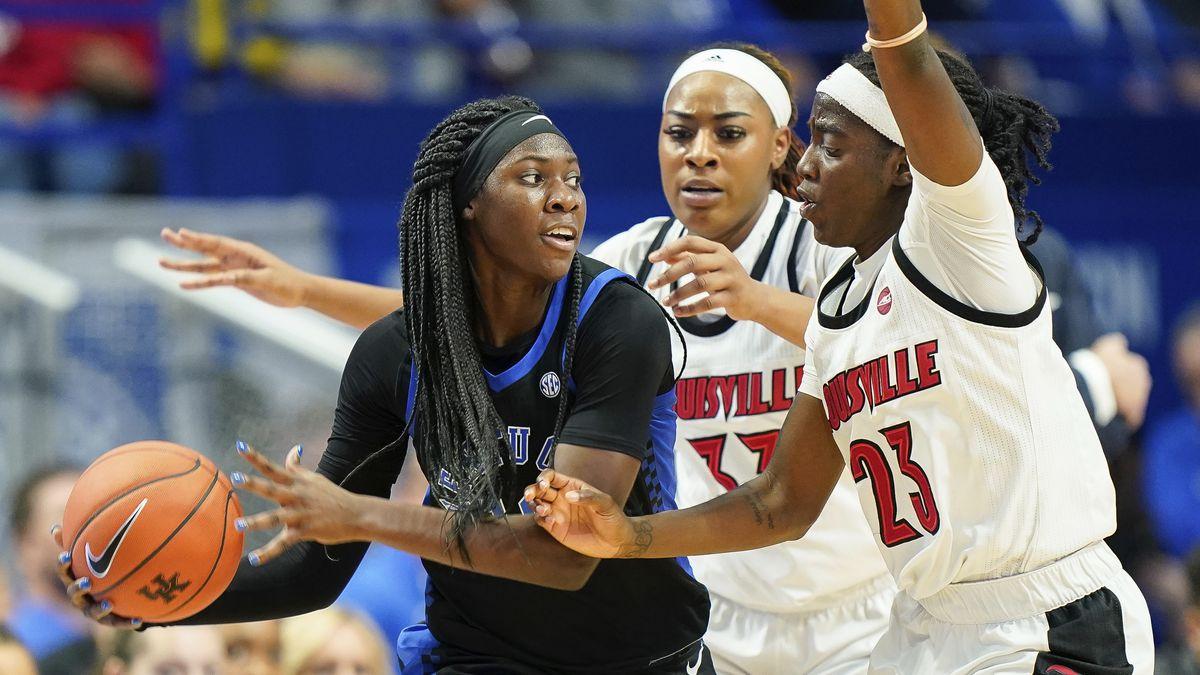 Kentucky guard Rhyne Howard (10) dribbles past Louisville guard Jazmine Jones (23) and forward...
