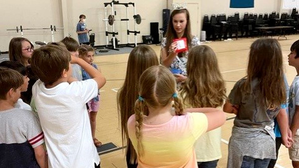 Anita Cerpovicz, Miss East Georgia State College 2021, visits kids at Trinity Christian School...