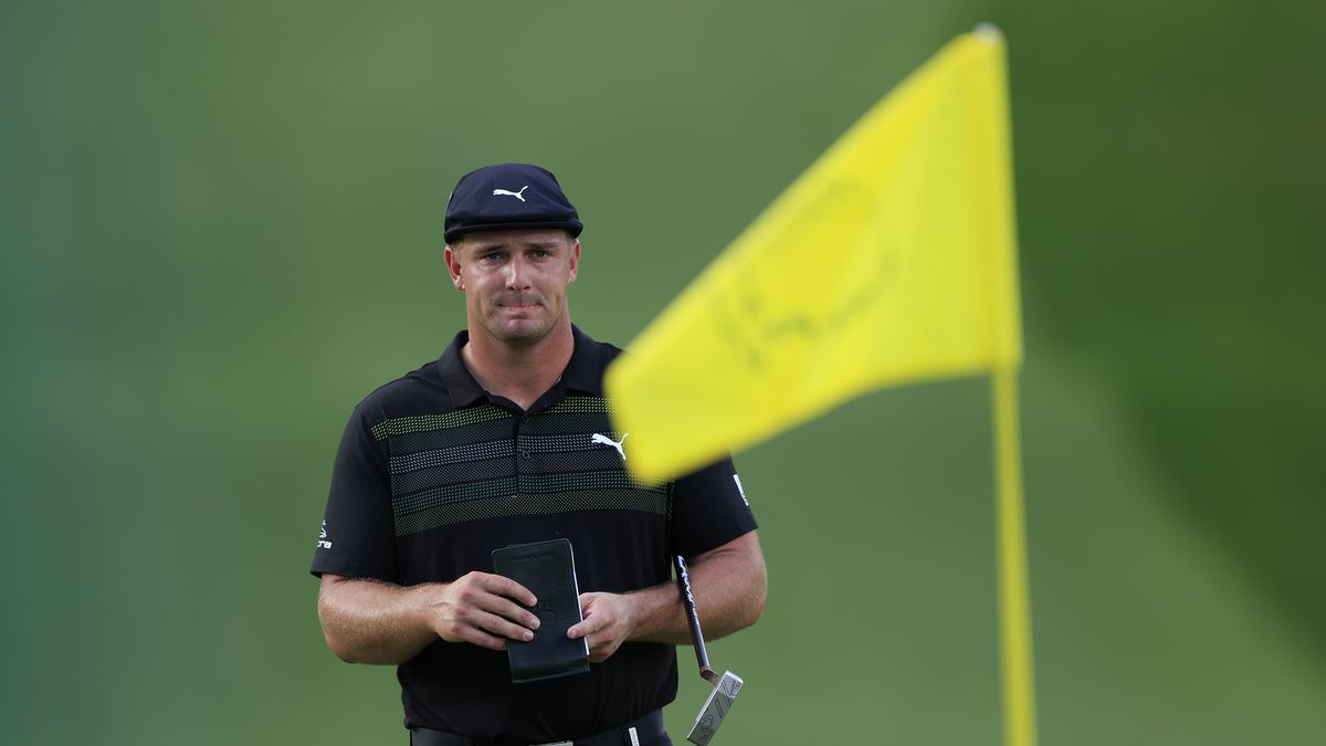 Bryson DeChambeau reads the No. 7 green during Round 1 of the Masters at Augusta National Golf...