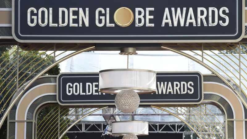 FILE - Event signage appears above the red carpet at the 77th annual Golden Globe Awards,...