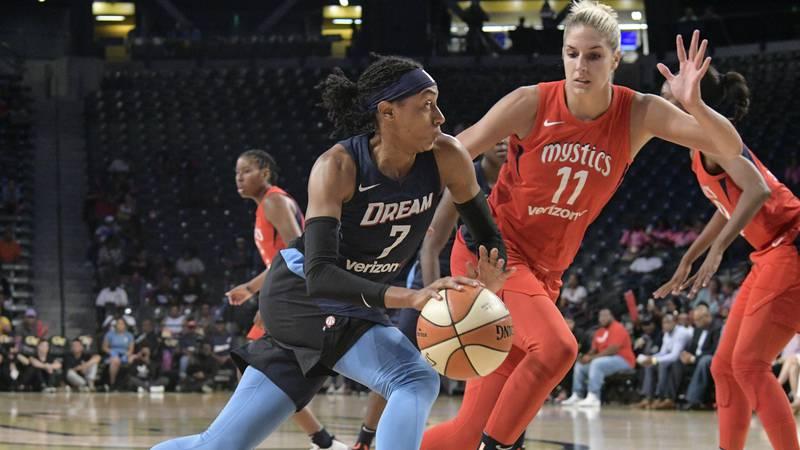 Atlanta Dream guard Brittney Sykes (7) drives against the defense of Washington Mystics guard...