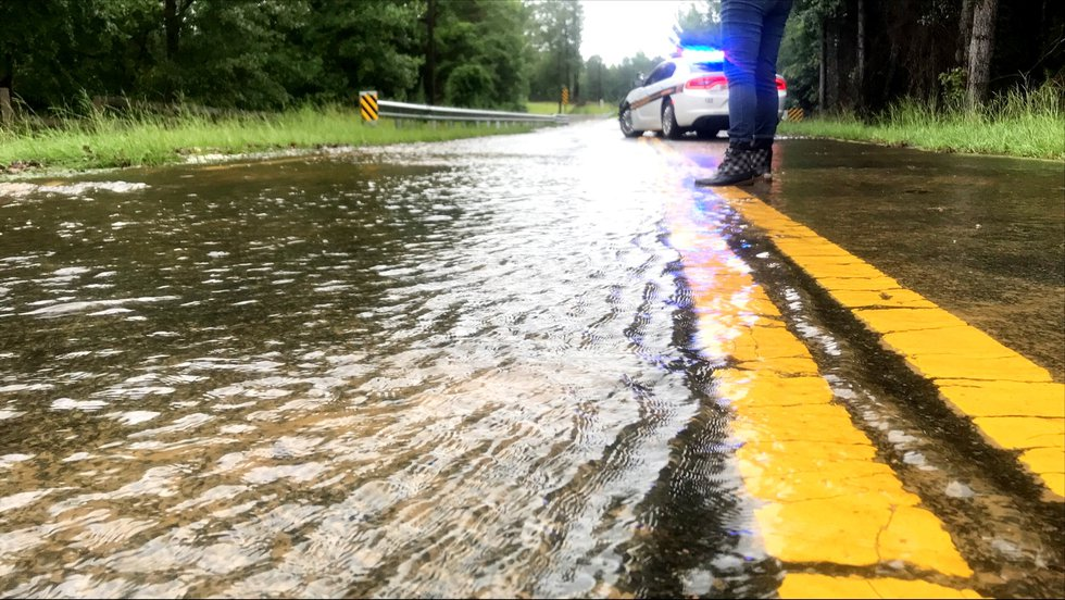 Water covers Old Shoals Road on Tuesday morning after flooding closed a bridge near Monetta.