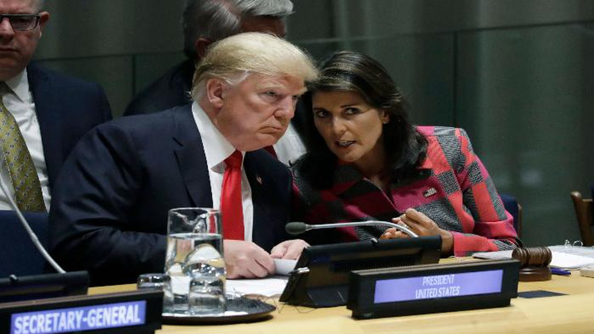 FILE- In this Sept. 24, 2018 file photo, President Donald Trump talks to Nikki Haley, the U.S....