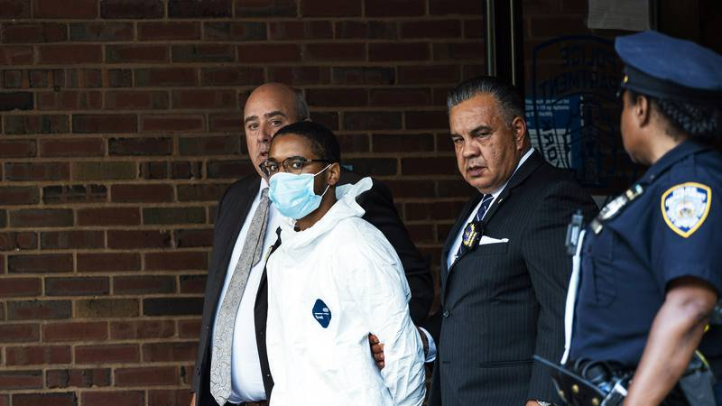 Tyrese Haspil, 21, is escorted out of the 7th precinct by NYPD detectives, Friday, July 17,...