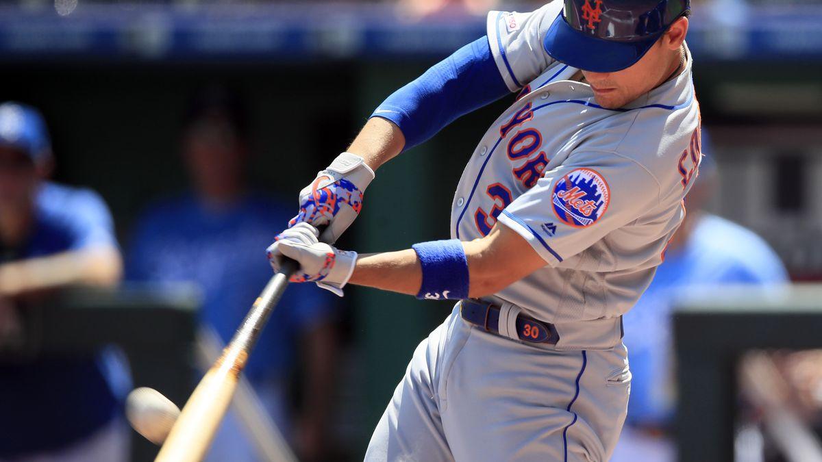 New York Mets' Michael Conforto hits a three-run home run off Kansas City Royals starting pitcher Glenn Sparkman during the first inning of a baseball game at Kauffman Stadium in Kansas City, Mo., Sunday, Aug. 18, 2019. (AP Photo/Orlin Wagner)