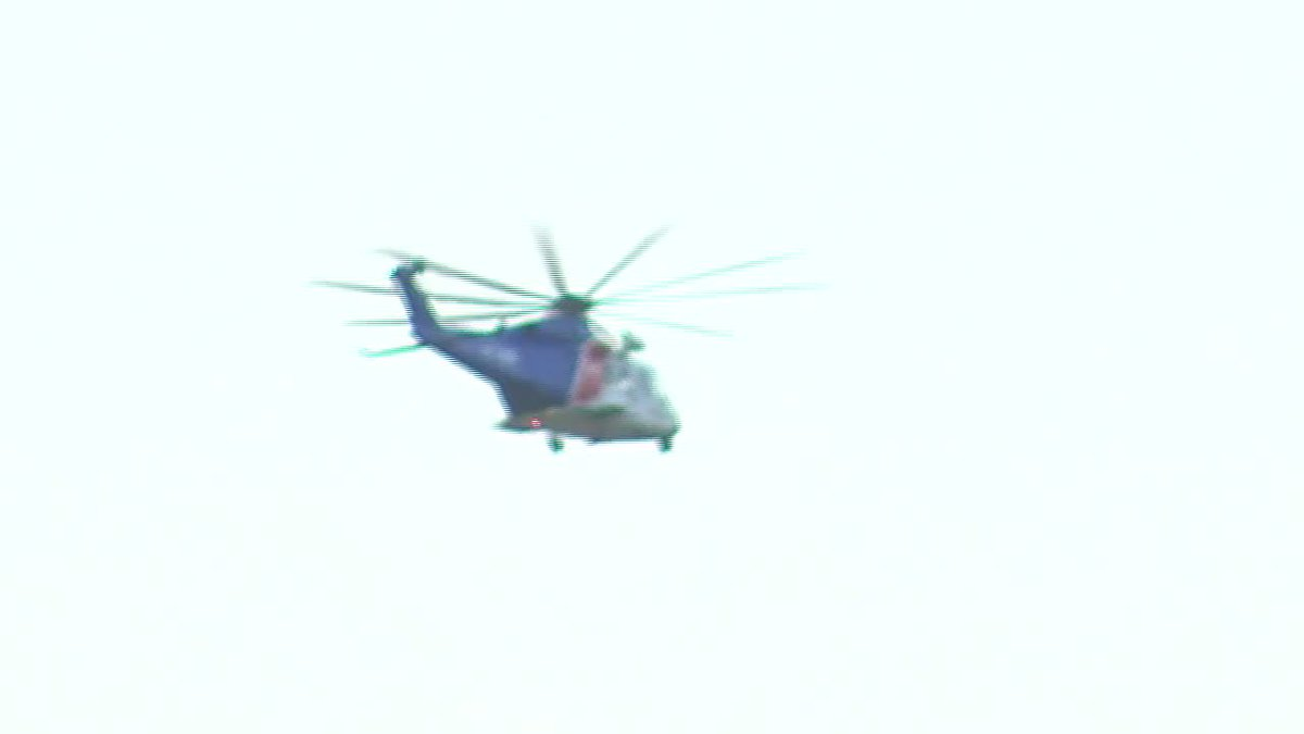 A photo of a Coast Guard helicopter heads out on a search.