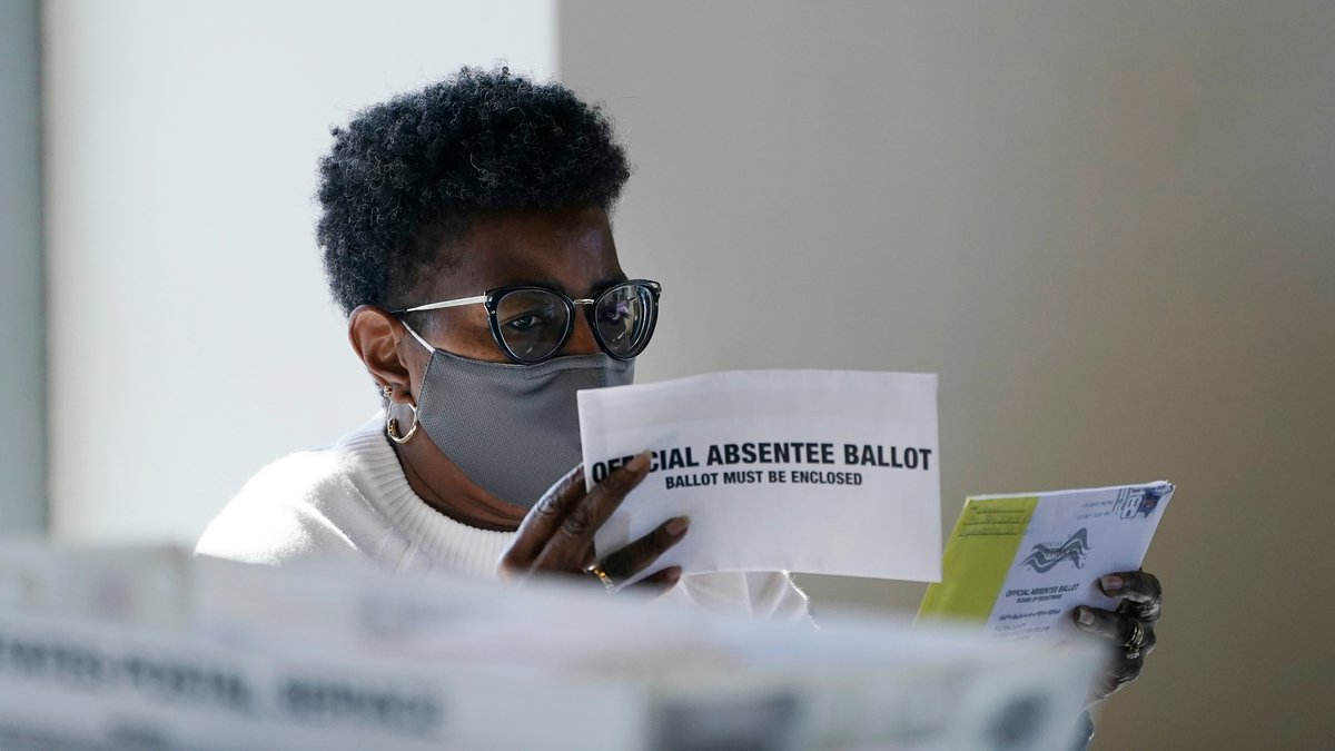 A worker at the Fulton County Board of Registration and Elections works to process absentee...