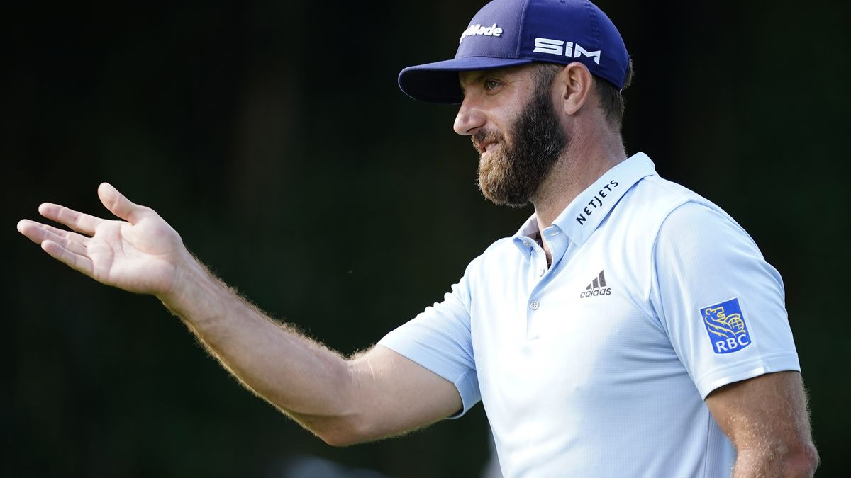 Dustin Johnson gestures on the No. 6 fairway during Practice Round 2 for the Masters at Augusta...