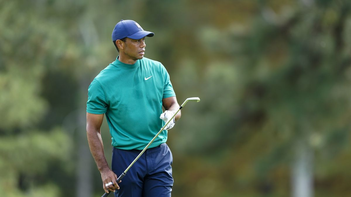 Masters champion Tiger Woods watches a stroke on the No. 15 fairway during Practice Round 2 for...