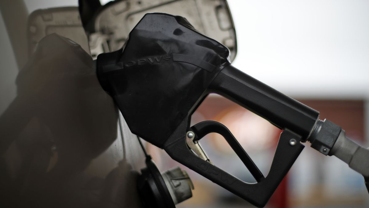 This is a gas pump nozzel in a car filling up at a pump in West Mifflin, Pa., on Friday, Nov....