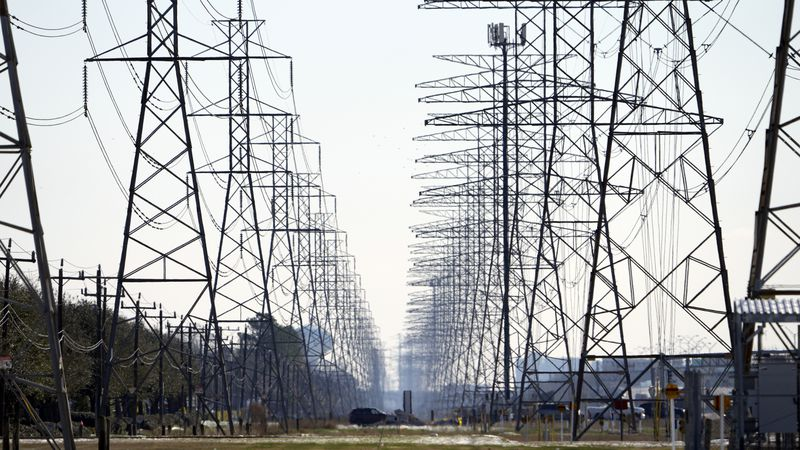 FILE - This Tuesday, Feb. 16, 2021 file photo shows power lines in Houston.
