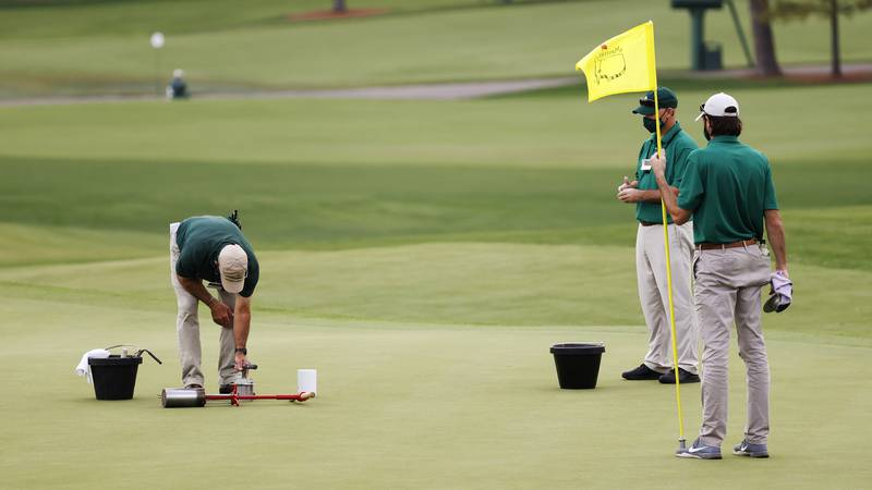 Greenkeepers switch hole locations in between Round 1 and Round 2 of the Masters at Augusta...