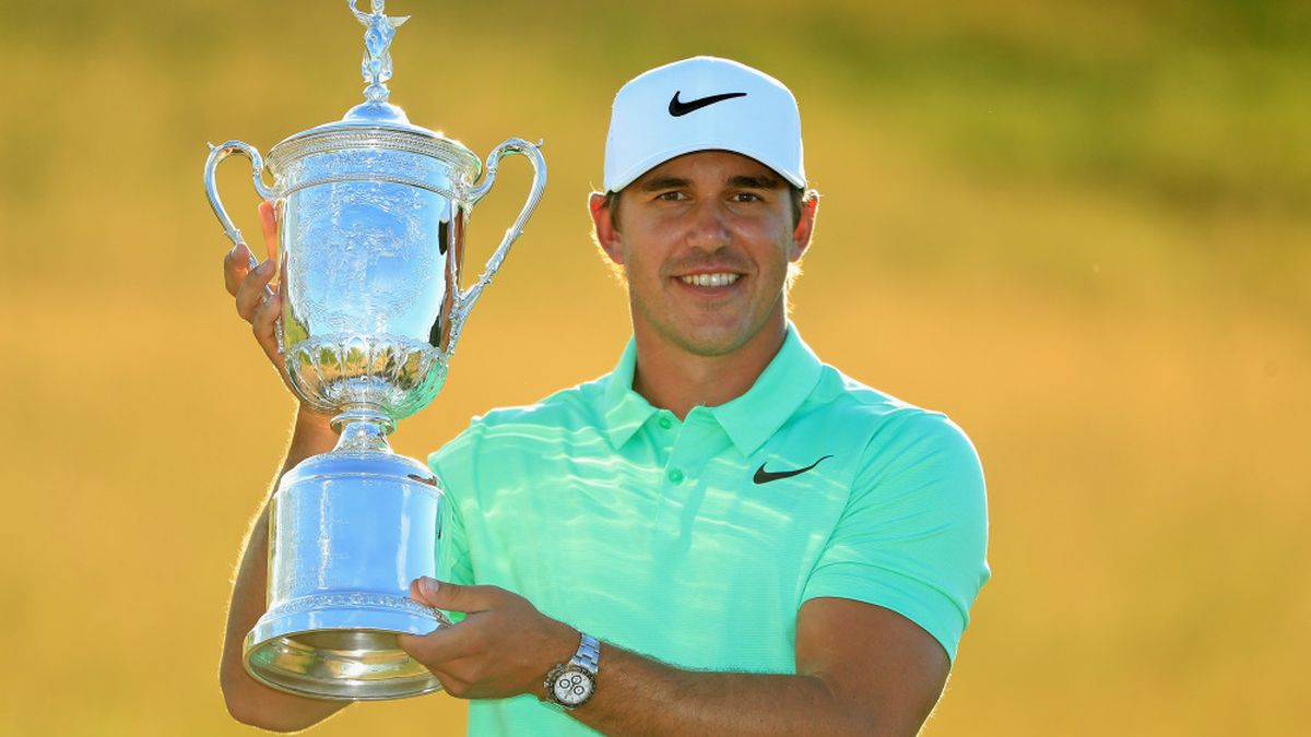 HARTFORD, WI - JUNE 18:  Brooks Koepka of the United States poses with the winner's trophy after his victory at the 2017 U.S. Open at Erin Hills on June 18, 2017 in Hartford, Wisconsin.  (Photo by Andrew Redington/Getty Images)