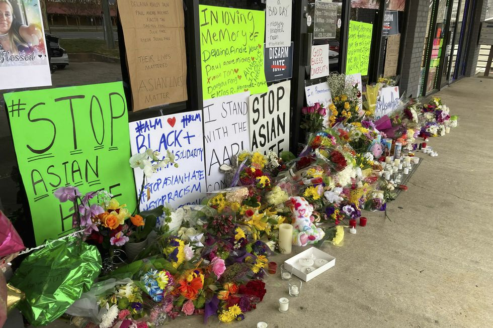 A make-shift memorial is seen Friday, March 19, 2021, in Acworth, Ga., in the aftermath of...