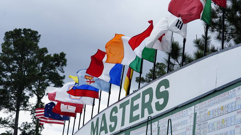 International flags fly from the Main Scoreboard on No.1 during Round 2 of the Masters at...