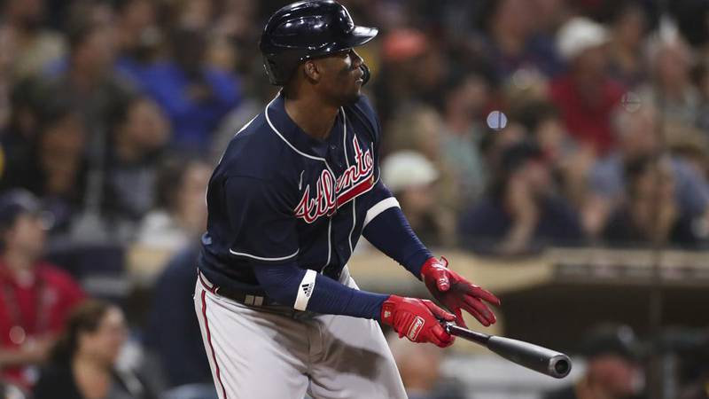 Atlanta Braves' Jorge Soler watches his RBI-double against the San Diego Padres in the 10th...