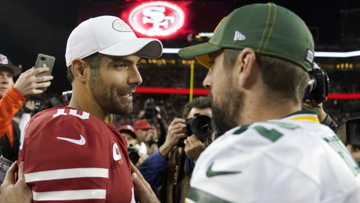 San Francisco 49ers quarterback Jimmy Garoppolo, left, greets Green Bay Packers quarterback...