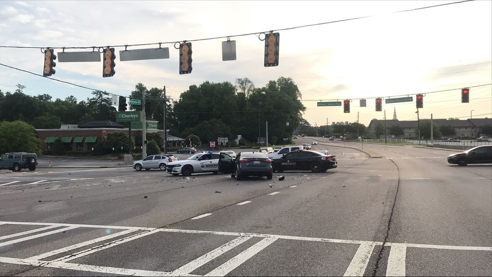 This was the scene after a crash in the busy Augusta Exchange shopping area that left a garbage...