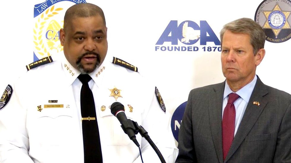 Richmond County Sheriff Richard Roundtree and Gov. Brian Kemp discuss a big gang bust during a...