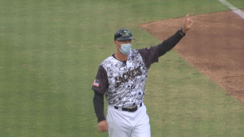 Augusta GreenJackets manager Michael Saunders, doubling as the team's third base coach, flashes...
