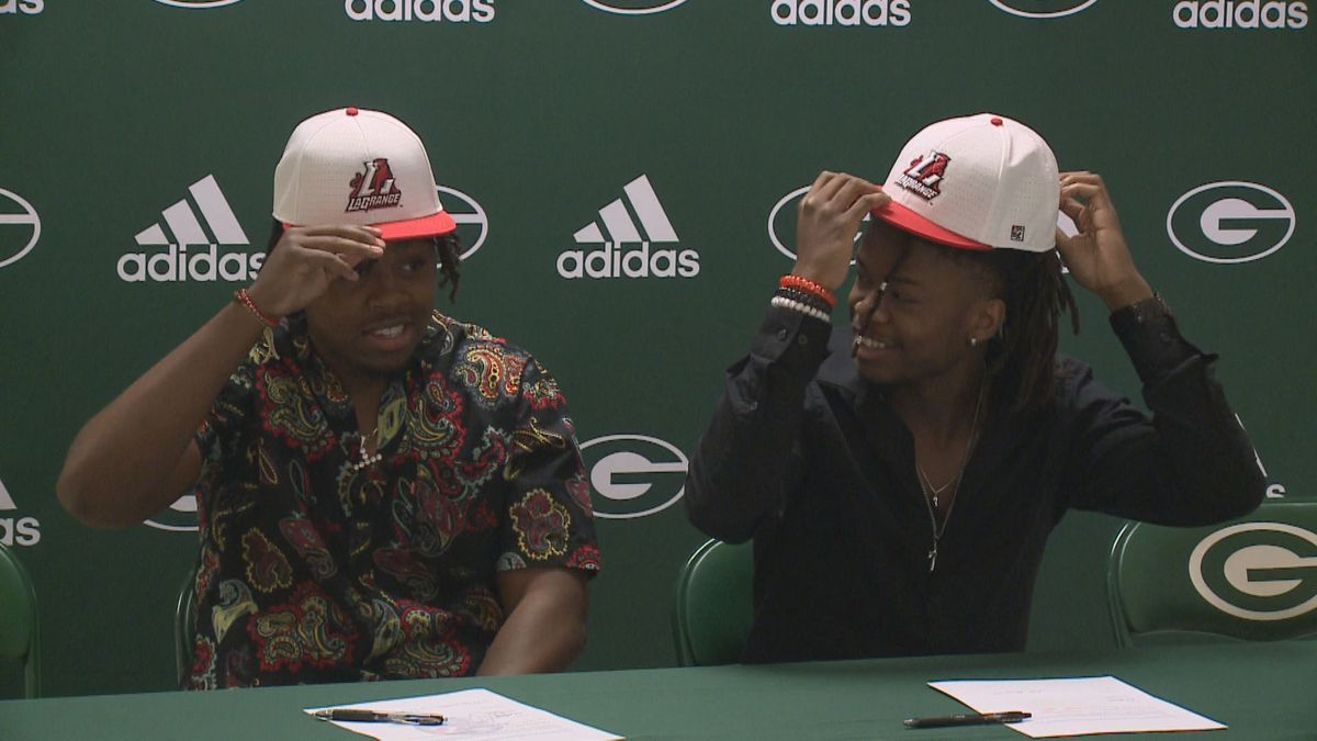 Fazon Abrams and Tre Harris sign their letters of intent to play football at La Grange.