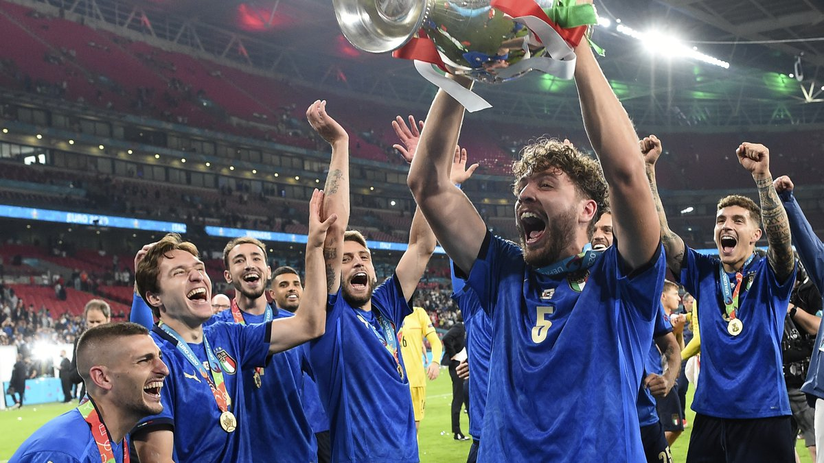 Italy's players celebrate with trophy after winning the Euro 2020 soccer championship final...