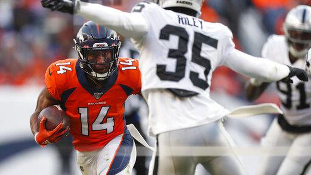 Denver Broncos wide receiver Courtland Sutton (14) looks for a way around Oakland Raiders free safety Curtis Riley (35) during the first half of an NFL football game Sunday, Dec. 29, 2019, in Denver. (AP Photo/David Zalubowski)