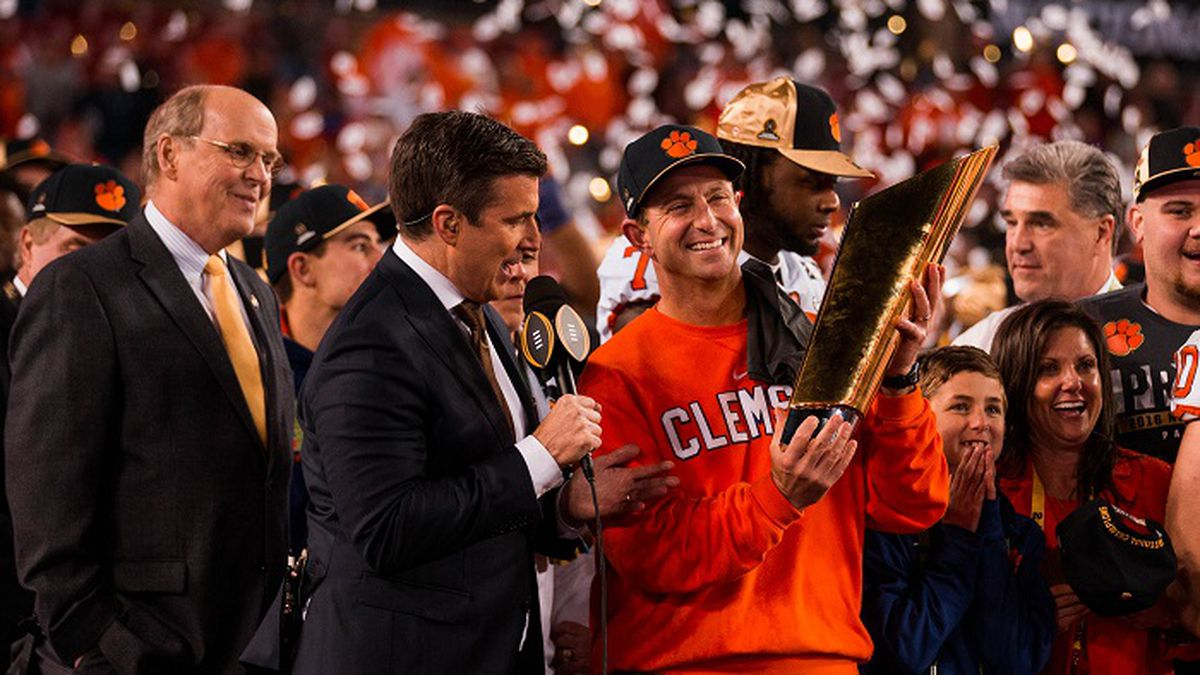January 9, 2017 Tampa, FL...Clemson head coach Dabo Swinney holds the Championship trophy while...