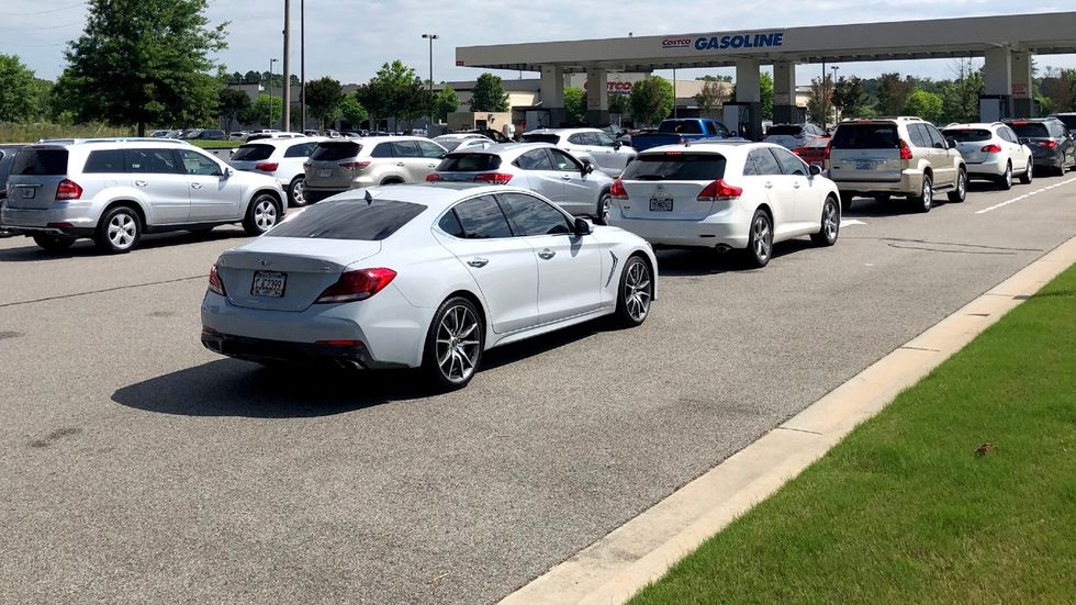 Cars line up to fuel up on May 11, 2021, at the Costco in Augusta.