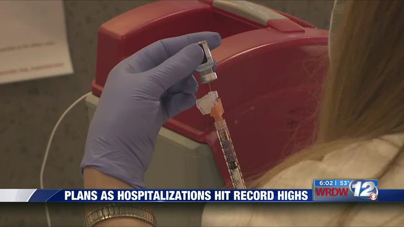 Plans as hospitalizations hit record highs
