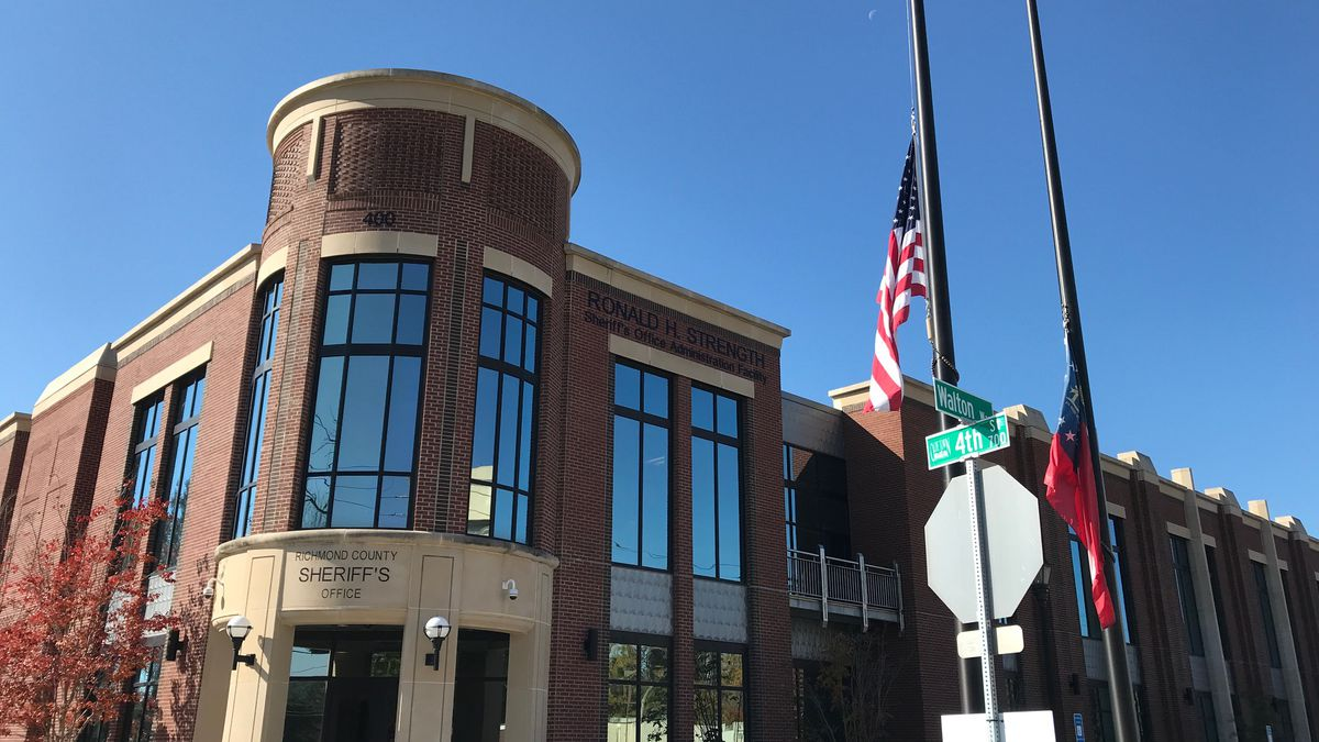 The flags outside the Richmond County Sheriff's Office were lowered Wednesday after the death...