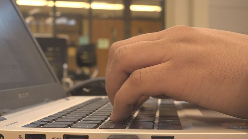 A student types on his keyboard at Iowa City West High School. The Iowa City Community School...