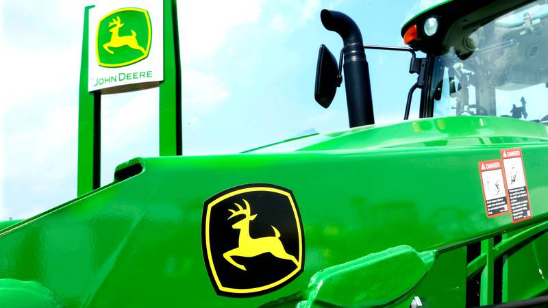FILE- In this Aug. 31, 2015, file photo, John Deere equipment is on display at the Farm...