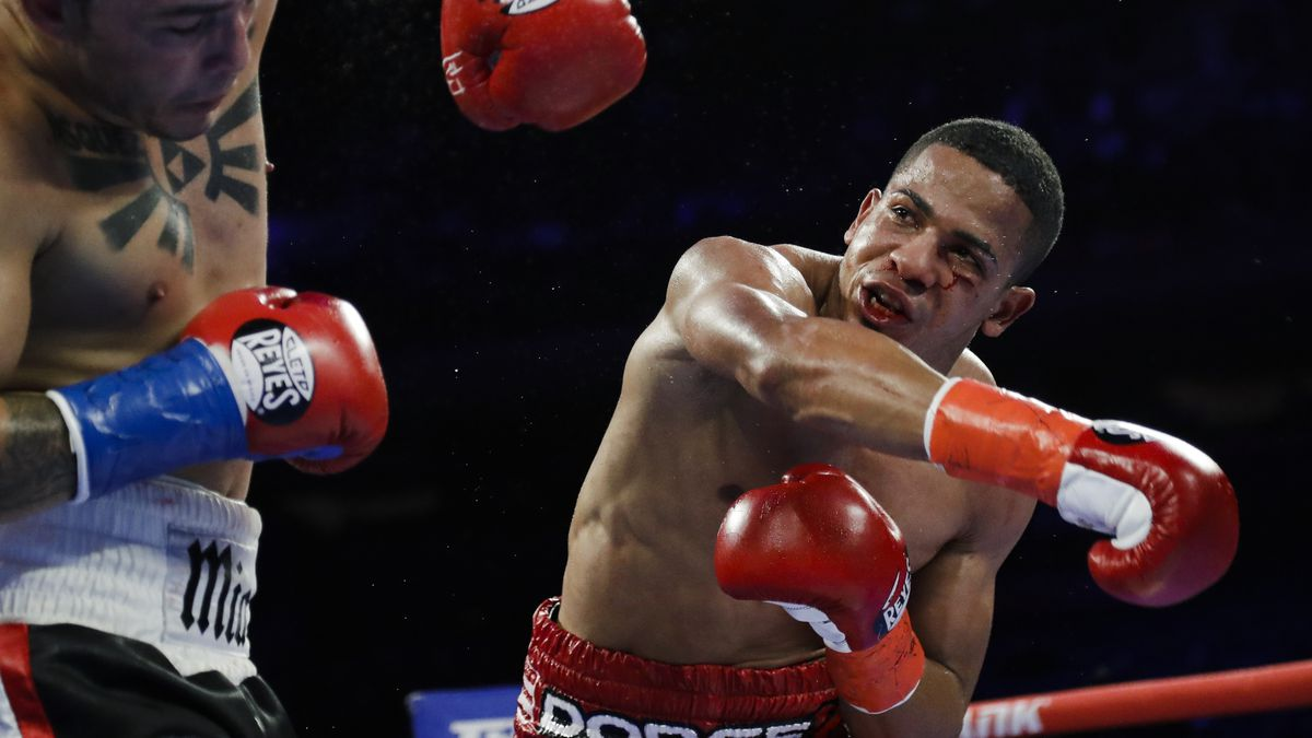In this April 20, 2019, file photo, Puerto Rico's Félix Verdejo, right, punches Costa Rica's...
