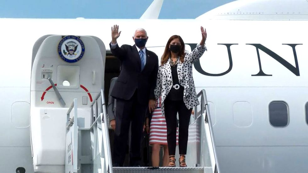 Vice President Mike Pence and his wife wave during their visit to South Carolina on July 21,...