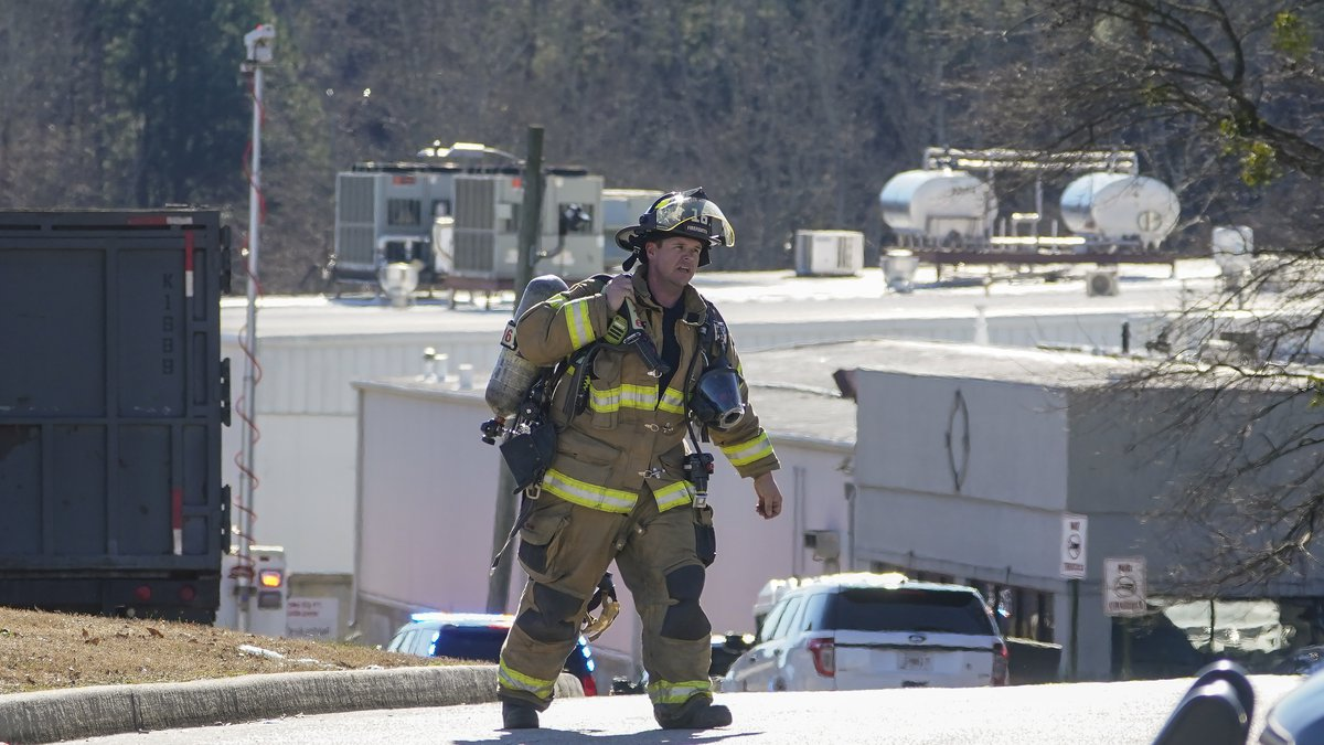 A Hall County firefighter leaves following a liquid nitrogen leak that killed six people at...