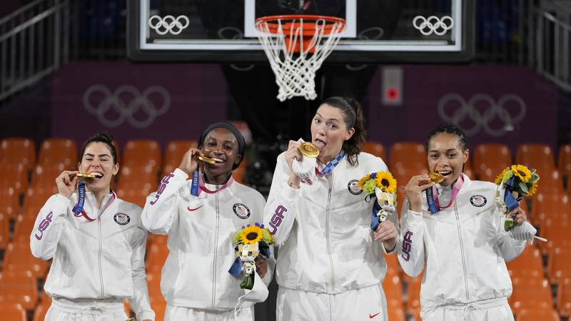 Members of team United States, from left to right, Kelsey Plum, Jacquelyn Young, Stefanie...