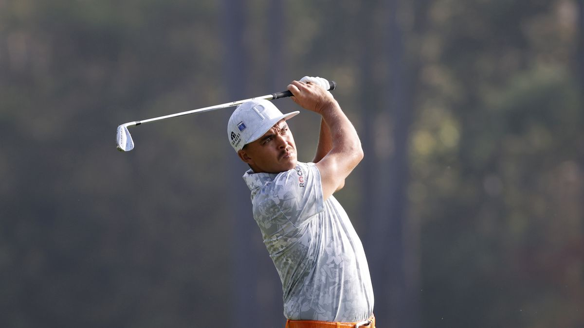 Rickie Fowler plays his stroke from the No. 12 tee during Round 4 of the Masters at Augusta...