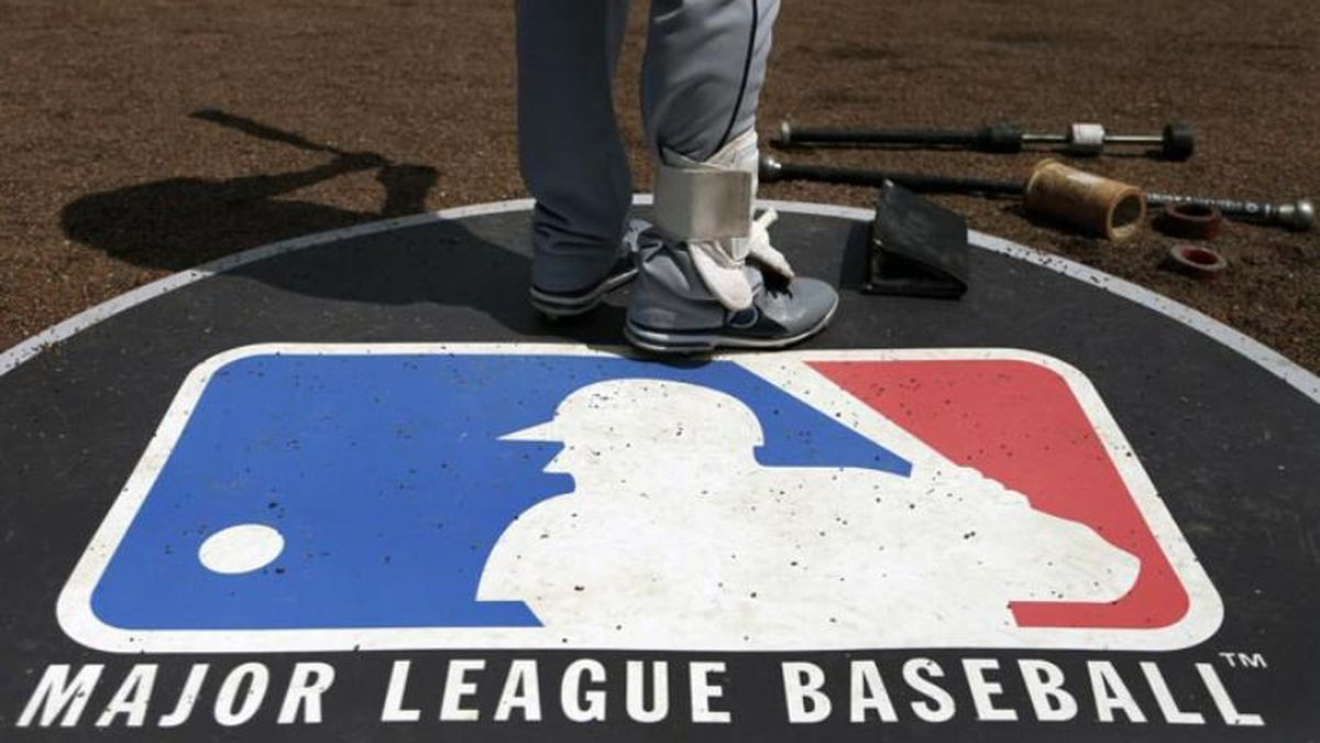FILE - In this April 24, 2013, file photo, Cleveland Indians second baseman Jason Kipnis stands on the Major League Baseball logo that serves as the on deck circle during the first inning of a baseball game between the Chicago White Sox and the Indians, in Chicago.