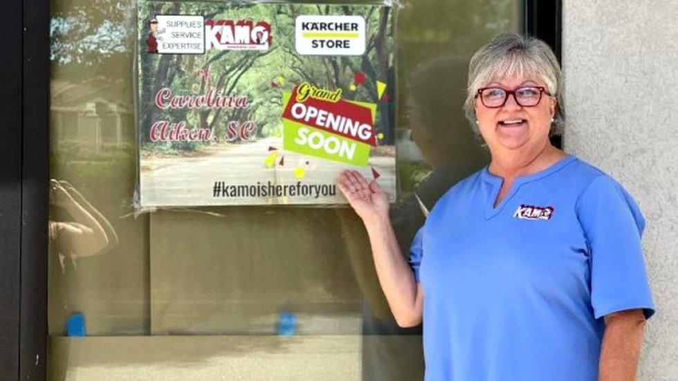 Lori Perry standing in front of the new KAMO showroom in Aiken.
