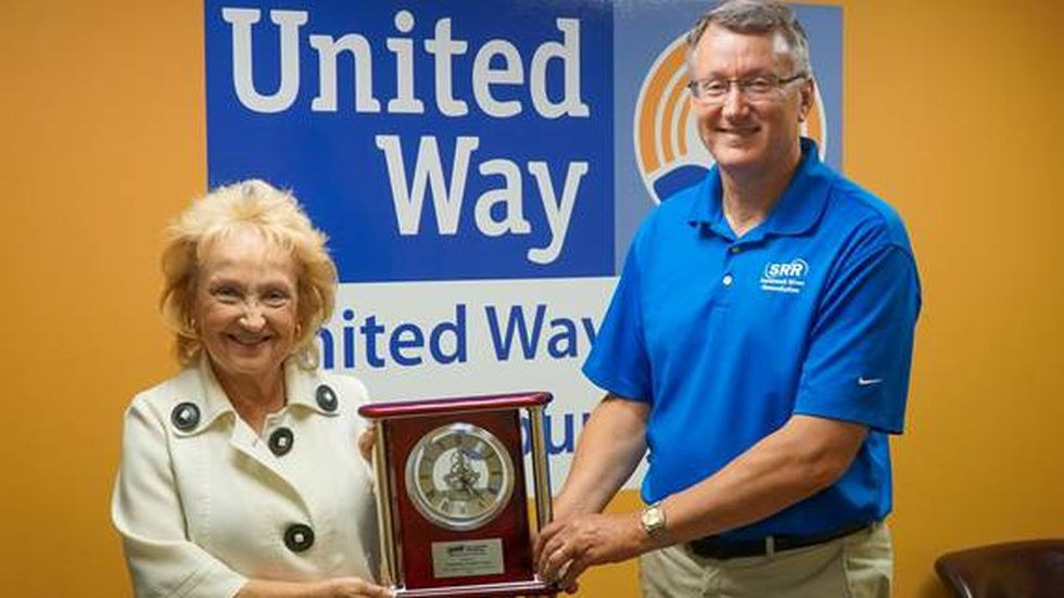 Aiken County United Way President Sharon Rodgers accepts gift of mantel clock from SRR...