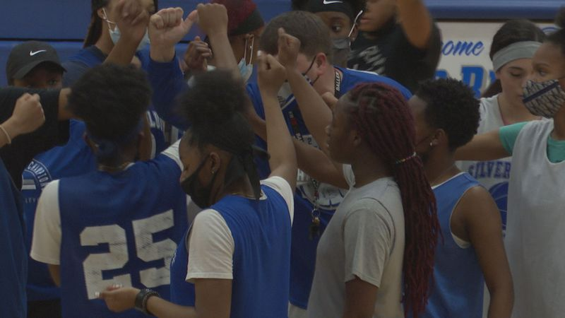 Silver Bluff girls basketball head coach Chasen Redd breaks down the huddle during a practice...
